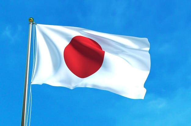 De vlag van japan op de blauwe hemelachtergrond Premium Foto