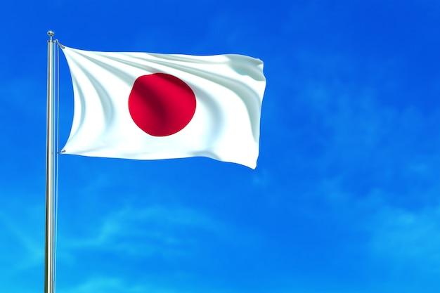 De vlag van japan op het blauwe hemel 3d teruggeven als achtergrond