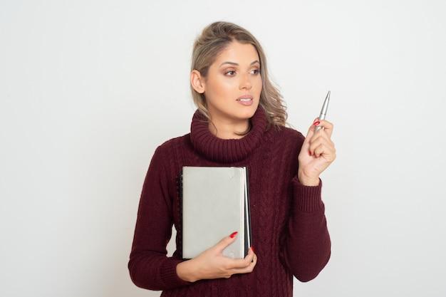 De vrouwelijke boeken en de pen van de studentenholding