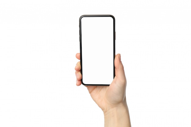 De vrouwelijke telefoon van de handholding met het lege scherm, dat op witte oppervlakte wordt geïsoleerd