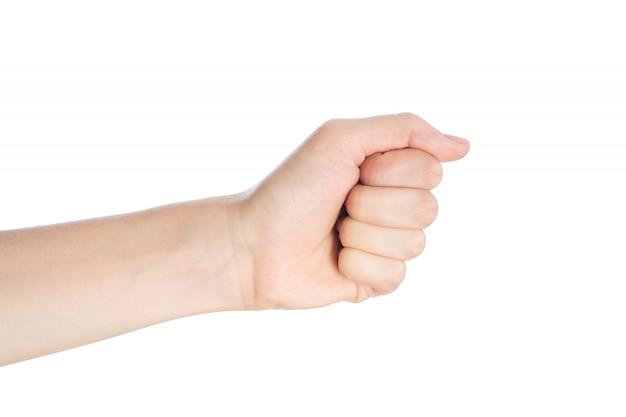 De vrouwenhand toont vuistgebaar op een witte oppervlakte wordt geïsoleerd die