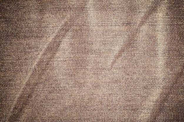 De vuile gescheurde textuur van denimjeans.