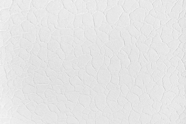 De witte achtergrond van de gipspleistertextuur. witte structurele muurachtergrond. oude grunge textuur achtergrond.