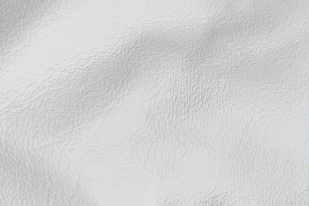 De witte glanzende achtergrond van de leertextuur