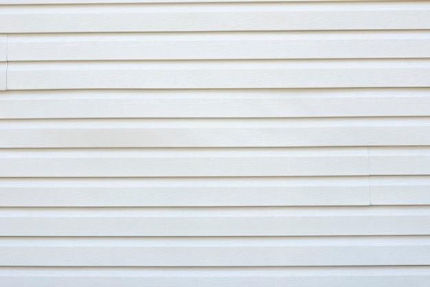 De witte houten achtergrond van de plankenmuur