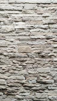 De witte stenen muur patroon textuur achtergrond.