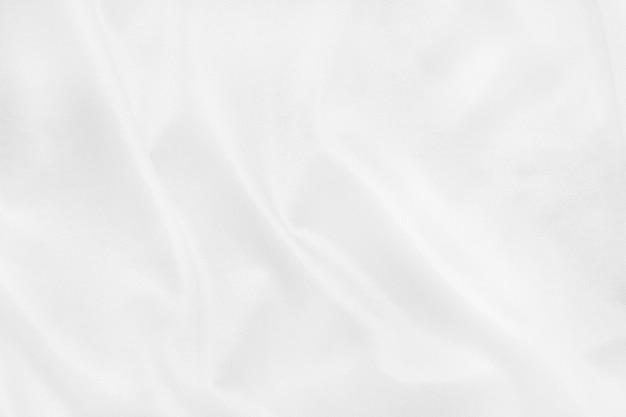 De witte textuur van de stoffendoek voor het achtergrond en ontwerpkunstwerk