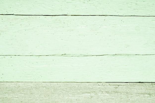 De zachte groene achtergrond van de kleuren houten textuur