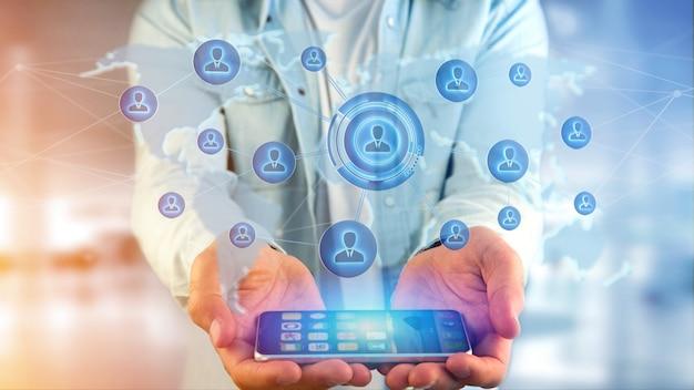 De zakenman die een smartphone met een netwerk over een verbonden 3d wereldkaart gebruiken, geeft terug