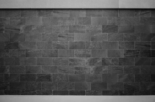 De zwarte achtergrond van de bakstenen muurtextuur