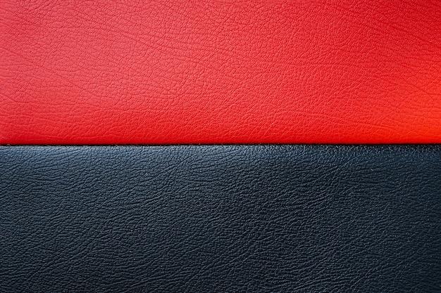 De zwarte en rode textuur van het bankleer kan als achtergrond worden gebruikt