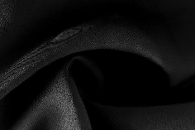 De zwarte stof van de close-uptextuur van kostuum