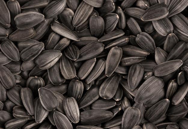 De zwarte textuur of de achtergrond van zonnebloemzaden