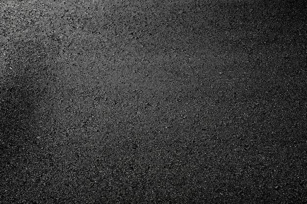 De zwarte textuur van de asfaltweg - achtergrond