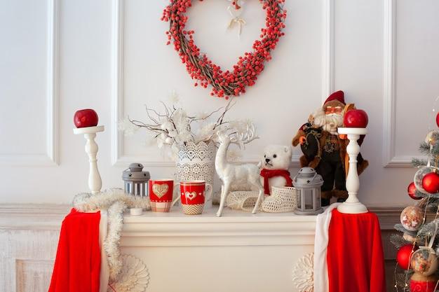Decor open haard kaarsen en keramische herten