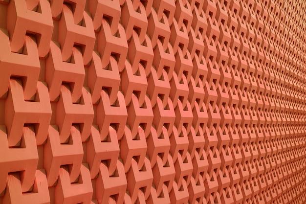 Decoratief patroon van de bouw van de muur in diep oranje
