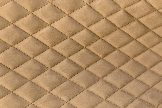 Decoratieve achtergrond van stof met dekvloer van het coach-type