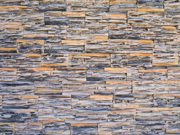 Decoratieve bruine stenen muurtegels.