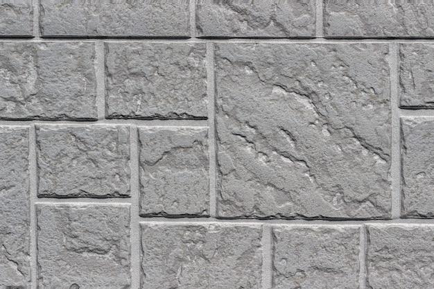 Decoratieve de achtergrond of de textuur van de baksteen grijze muur dichte omhooggaande asa