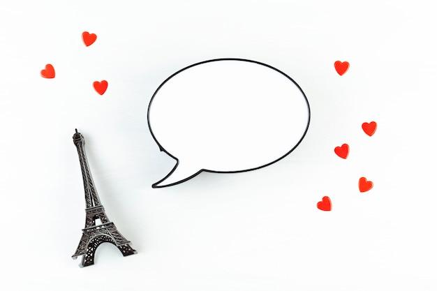 Decoratieve eiffeltoren met lichtbak in de vorm van een tekstballon met de ruimte voor het sms-bericht