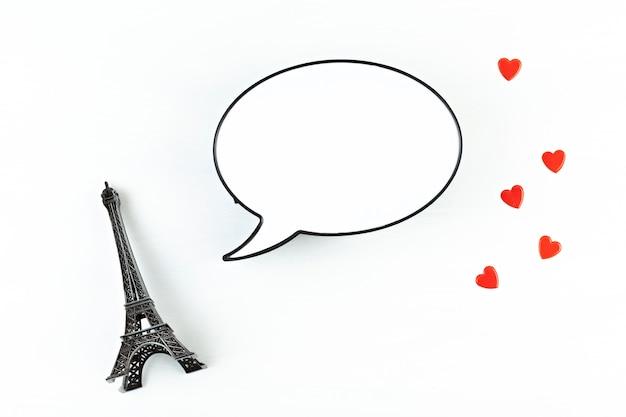 Decoratieve eiffeltoren met lichtbak in de vorm van tekstballon met de ruimte voor het sms-bericht