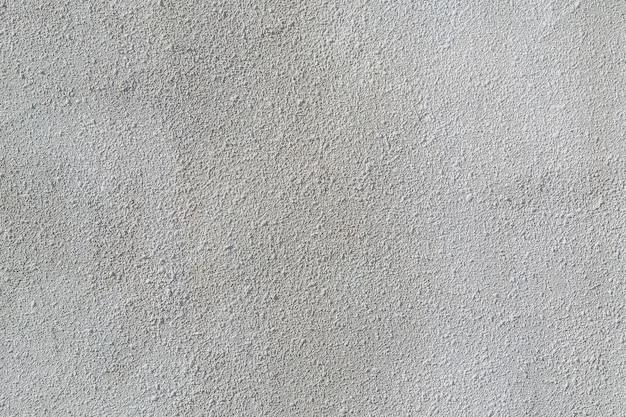 Decoratieve grijze pleister op de muur in het gebouw tijdens renovatiewerkzaamheden