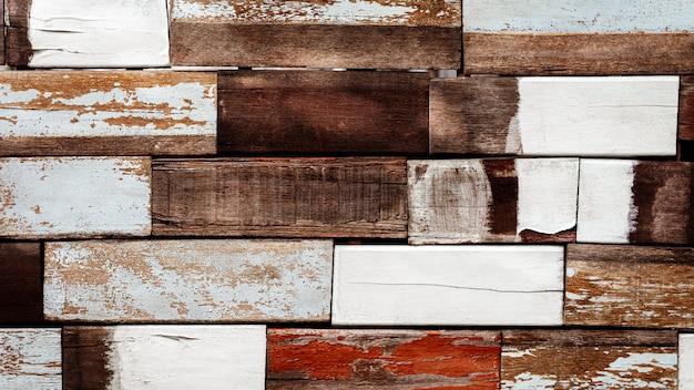 Decoratieve oude houten muurtextuur als achtergrond.