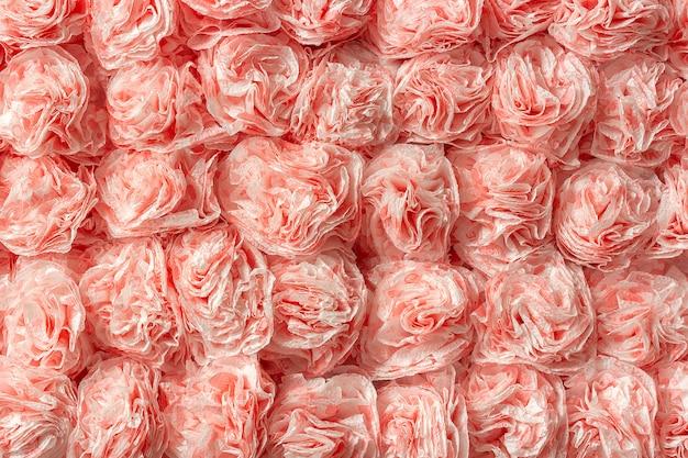 Decoratieve papieren rozen van servetten als patroon achtergrondpatroon