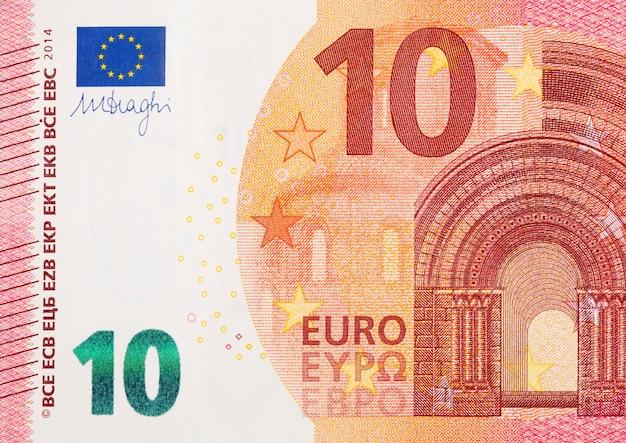 Deel van 10 euro bankbiljet close-up fragment met kleine rode details