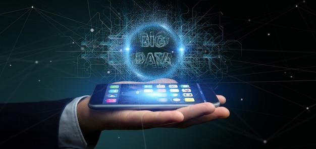 Deeltjes big data titel vasthouden door een zakenman