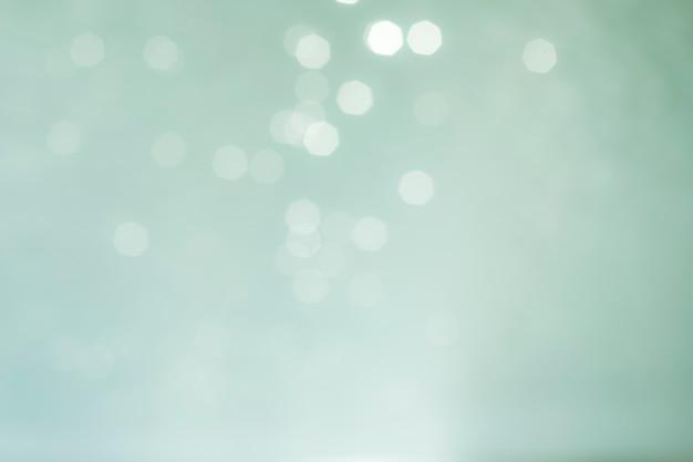 Defocused blauwe lichten abstracte achtergrond. natuurlijke foto bokeh