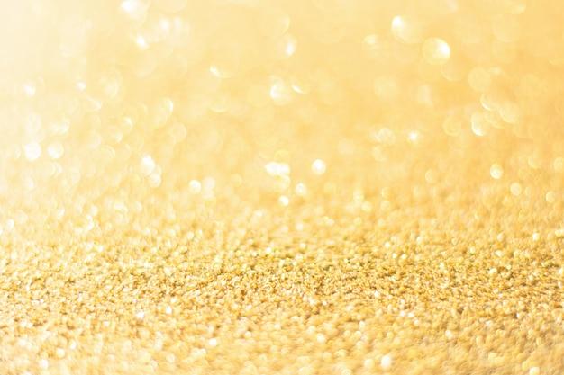 Defocused goud glitter achtergrond. gouden abstracte bokeh achtergrond.