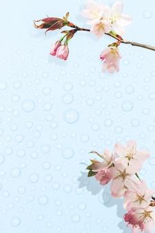 Delicate lente blauwe achtergrond met dauwdruppels en bloeiende boomtakken