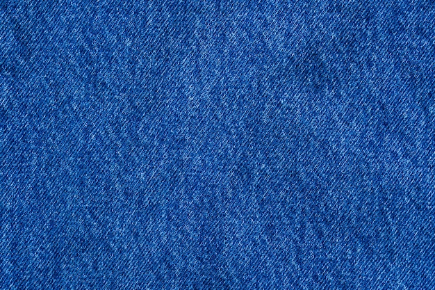 Denim blue jeans textuur close-up achtergrond bovenaanzicht
