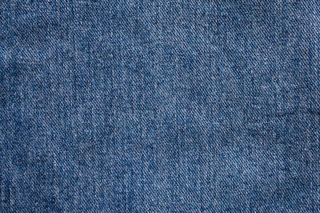Denim blue jeans textuur close-up achtergrond bovenaanzicht