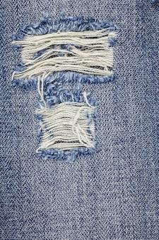 Denim gescheurde spijkerbroek textuur.