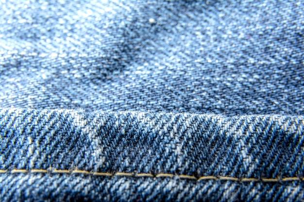 Denim jeans textuur achtergrond met oude gescheurde / fashion jeans / de textuur van de katoenen stof.