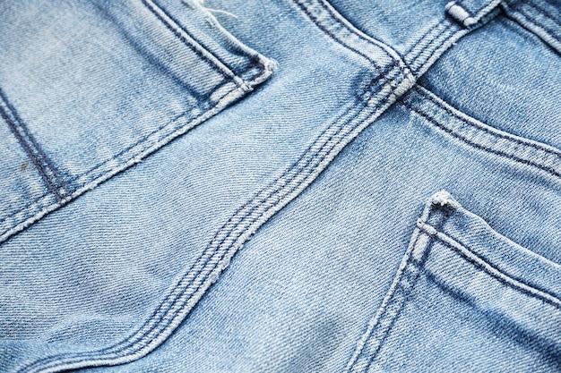 Denim patroon, blauwe spijkerbroek. klassieke jeans textuur