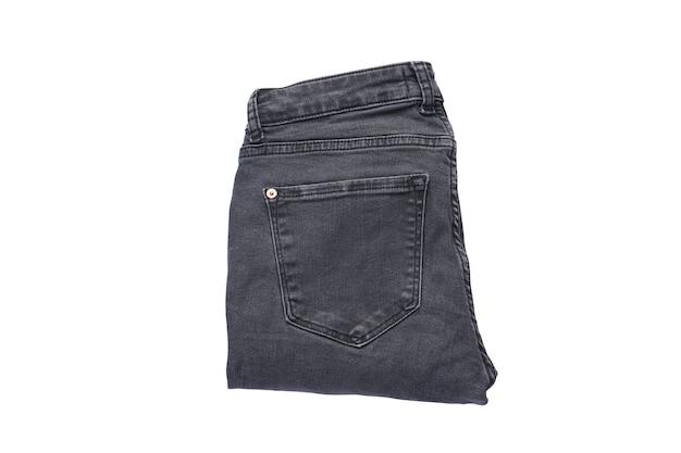 Denim patroon, grijze jeans geïsoleerd. gevouwen jeans, platliggend.