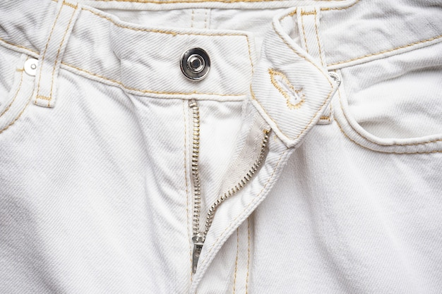 Denim textuur, close-up. witte spijkerbroek.