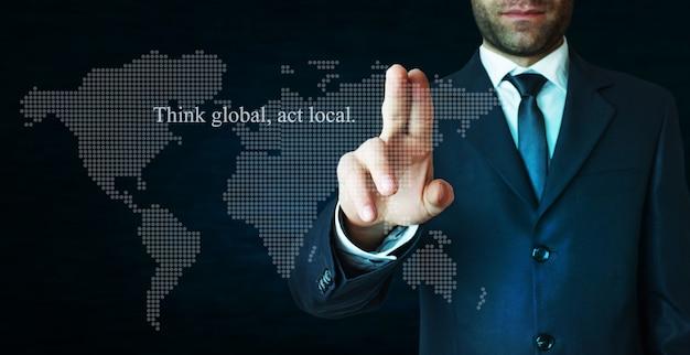 Denk aan global act lokale tekst op donkerblauwe achtergrond