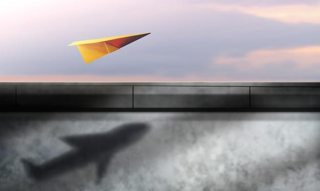 Denk groot, opstarten en motivatie concept. papieren vliegtuigjes die in de lucht vliegen en schaduw als vliegtuigen op de muur in de schaduw stellen