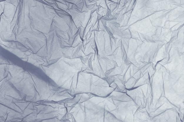 Detail van de textuur van een blauwe plastic zak