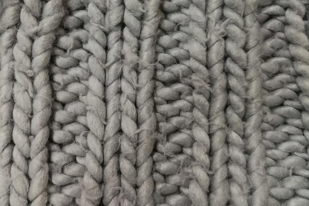 Detail van een rustiek handgemaakt dik vloerkleed.