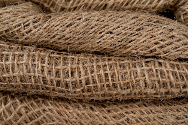 Detail van gevouwen ruwe jute materiële achtergrond natuurlijke zak geweven voor achtergrond