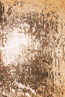 Detail van glanzend gouden lovertje op achtergrond