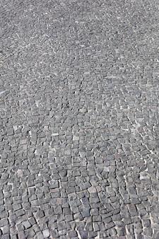 Detail van het blok stenen pad