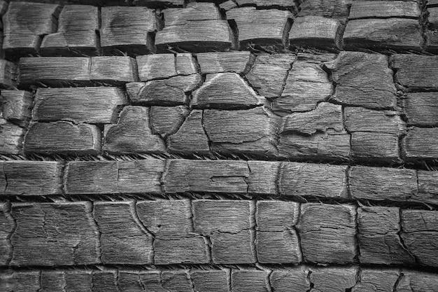 Details over het oppervlak van houtskool zwart en wit