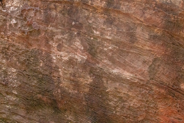 Details van natuurlijke de textuurachtergrond van de zandsteen
