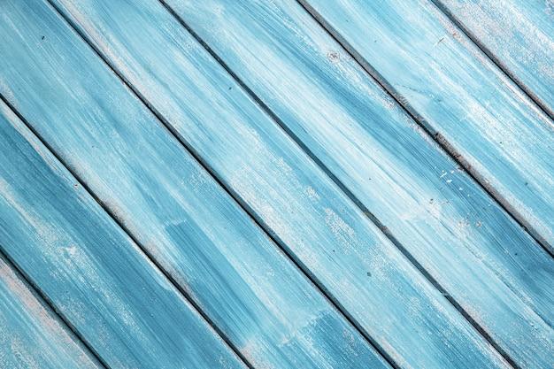 Diagonale houten blauwe achtergrond met textuur